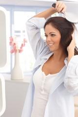 Young woman having hairdo
