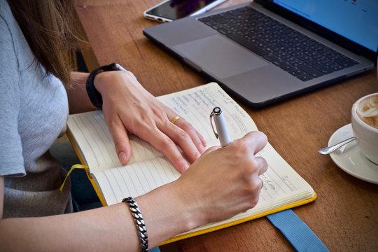 Woman writing working