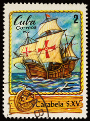 Ancient sailing ship - caravel on postage stamp