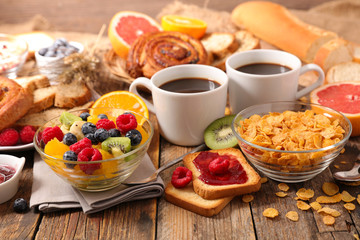 breakfast with coffee,croissant and fruit