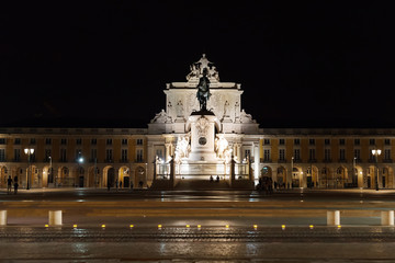 Triumphal Rua Augusta Arch and Statue of Dom Jose in Lisbon at night.