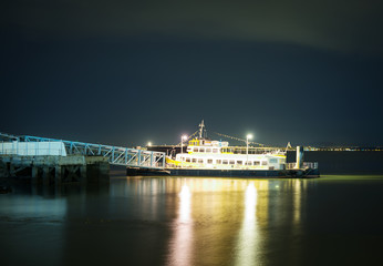 Moored ship at the pier at night.