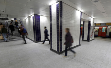 Passengers walk through the newly opened areas of Bond Street underground station, in London