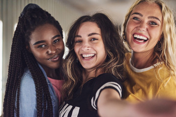 Diverse group of young female friends taking a selfie together