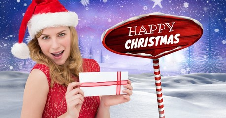 Happy Christmas text and female Santa holding gift with Wooden