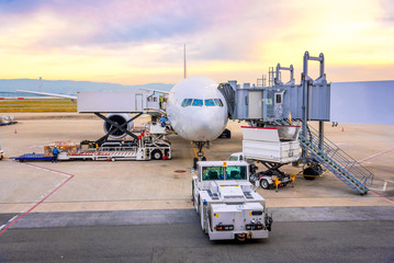 Airport ramp service for for a commercial plane landing at Narita International Airport in Tokyo,Japan.