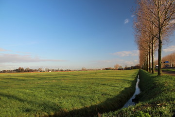Wide angle view of the  lowest area in western europe named Zuidplaspolder with blue sky and white clouds  in Moordrecht, Netherlands