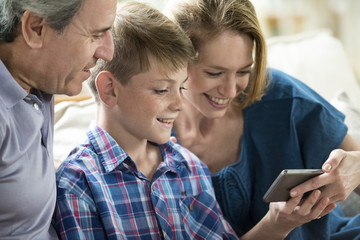 Family looking at smartphone together
