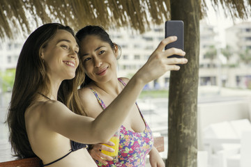 Women posing together for selfie