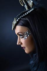 Beautiful woman with ornaments of rhinestone
