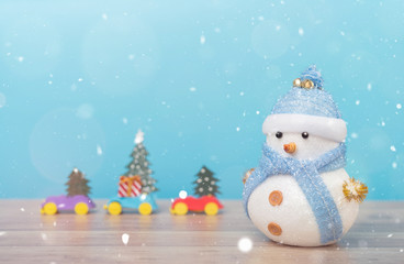 Happy snowman standing in winter christmas snow background. Merry christmas and happy new year greeting card with copy-space. Christmas celebration holiday background.