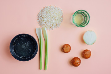 Flat lay of ingredients for risotto: chicken stock, arborio rice, mushrooms, wine, onion, celery,