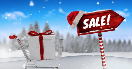 Sale text and gift in shopping trolley with Wooden signpost in