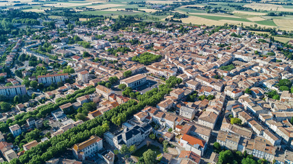 Aerial top view of residential area houses roofs and streets from above, old medieval town background, France