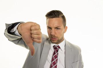 businessman shows thumbs down