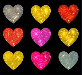 Set of glittering hearts isolated on black. VECTOR illustration