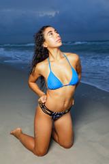 Bikini model on her knees