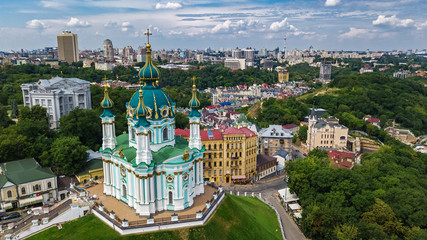 Aerial top view of Saint Andrew's church and Andreevska street from above, cityscape of Podol district, city of Kiev (Kyiv), Ukraine