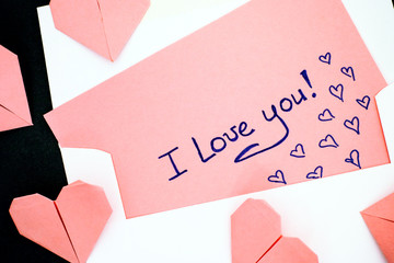 Letter with text I Love You! with envelope and pink origami hearts