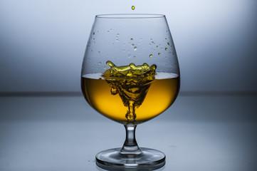 Wine glass splashing in glass