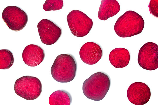 Raw beet slices isolated on white background