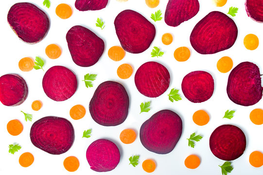 Raw beet and carrot slices isolated on white