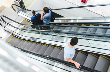 People on Escalator Motion Blurred, Top View. Abstract Blur Background of Moving Staircase