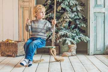 little boy getting ready for the holiday. Happy New Year and Merry Christmas