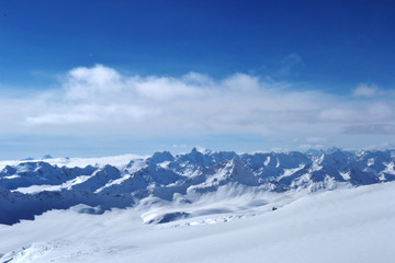 beautiful winter mountains with blue sky, snowy peaks. amazing scenic nature landscape.