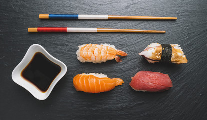 sashimi sushi set with chopsticks and soy