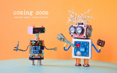 Web site under construction Coming Soon template page. Service robots maintenance with adjustable spanner screwdriver. orange background Wall mural