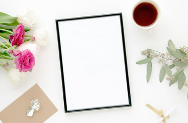 Styled scene with black frame, pink, white flowers, feminine flatlay, for mock-up