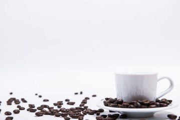 cup of coffee on a white background, scattered coffee beans, heart made of coffee beans, morning coffee at home
