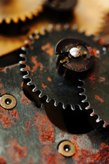 Rusty cogs gear mechanical transmission. industrial machinery vintage design wheels. Shallow depth field, selective focus.