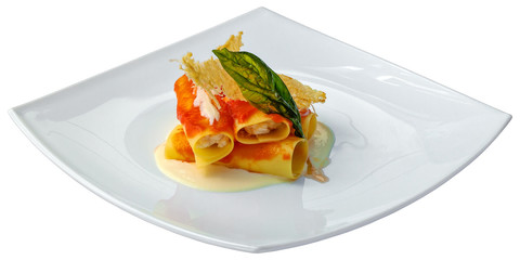 Italian food - Cannelloni with sauce and cheese.