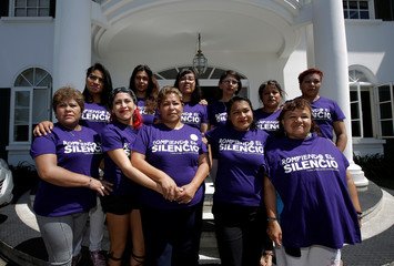 Victims of the 2006 land conflict in San Salvador Atenco, in Mexico, pose for a picture in front the Inter-American Court of Human Rights building after attending a hearing convened by the judges in San Jose