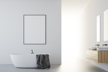 White bathroom with a poster