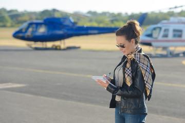 female pilot talking notes before flying