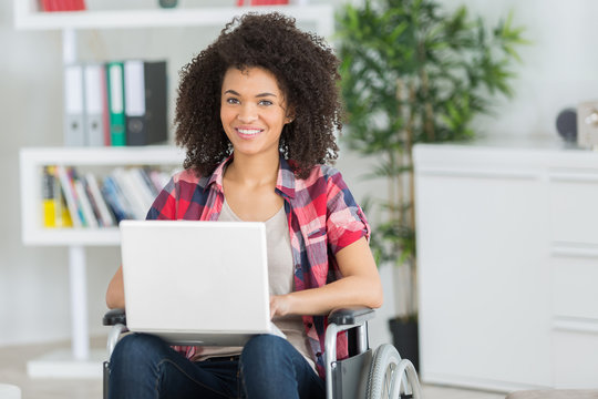 Lady in wheelchair using laptop