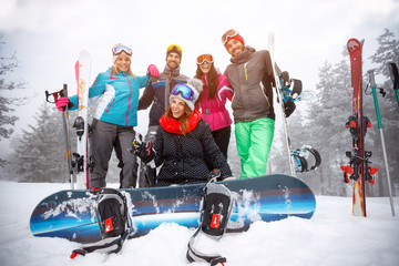 Group of friends on winter holidays - Skiers having fun on the snow