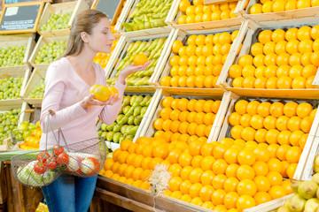 Customer choosing oranges