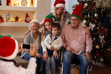 Happy family for Christmas making photo