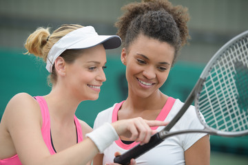 female tennis players having rest after the game