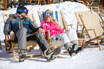 Couple enjoy at sun on ski terrain
