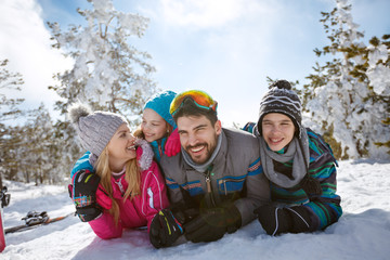 Family together in snowy nature