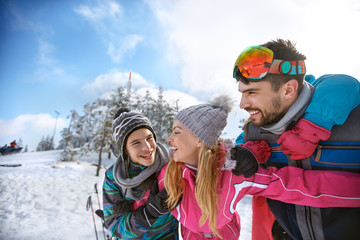 Family with children having fun on winter vacation