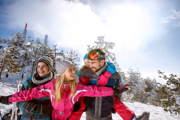 Woman and man with children having fun on skiing