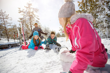 Family enjoying on snow on winter holiday