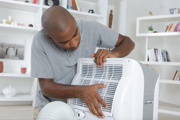 Man fixing fan