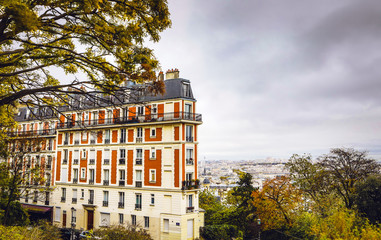 View from Montmartre to autumn rainy Paris.